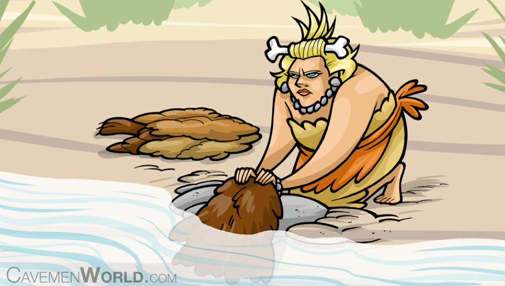 a cavewoman is washing clothes at the river